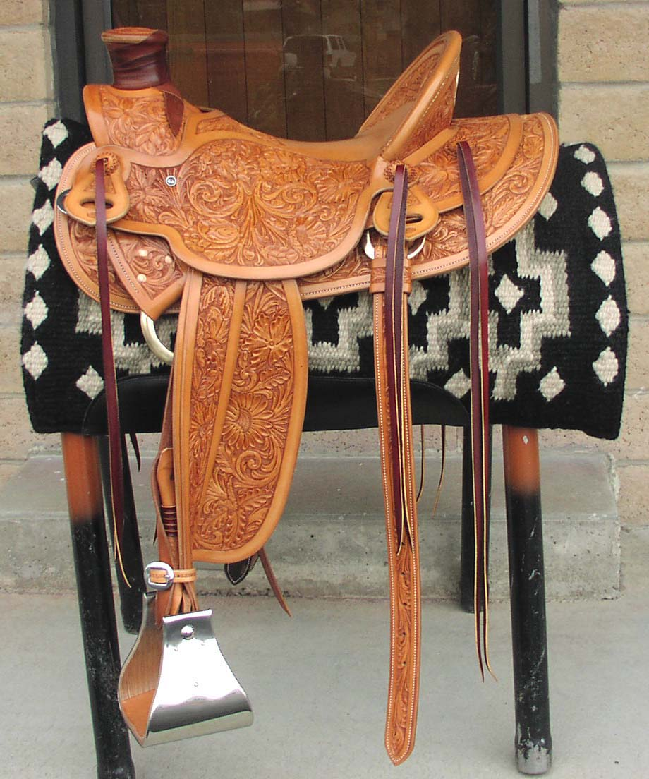This Custom hand made Wade saddle features a full multi floral tooled design. The stirrups are 6