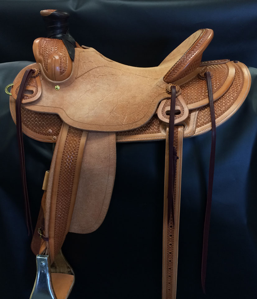 Our Will James crazy basket half breed tooled saddle has a 16
