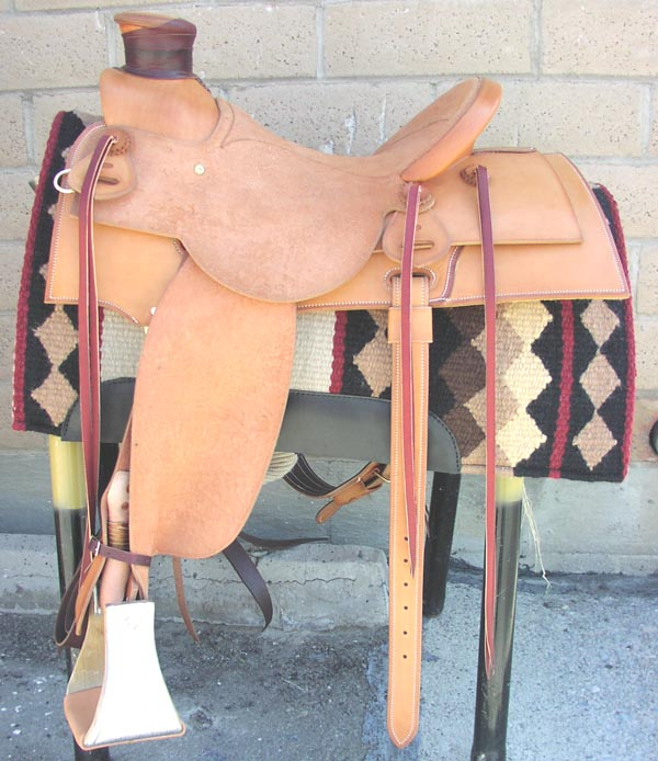 This Wade saddle features a combination smooth leather with rough out seat and fenders. Notice the closed gullet hole and the pointed square skirts. Why not order one for you today. Call 800-547-8477 and talk to TIP.