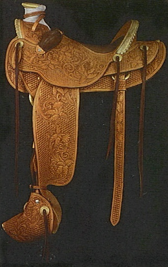 This handsome saddle features luxuious full quill ostrich inlaid seat and matching full quill ostrich bucking rolls.Authentic bulldog tapaderros tooled to match the floral lilly design with an outside basketweave.
